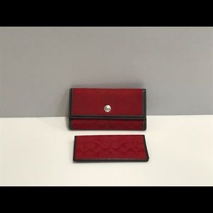 Coach wallet in red signature canvas.
